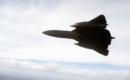 Air to air view bottom view of a 9th Strategic Reconnaissance Wings SR 71 Blackbird reconnaissance aircraft