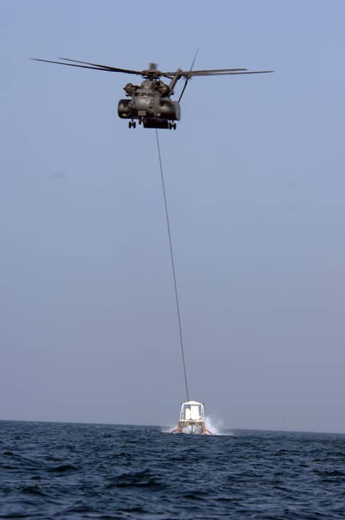 An MH 53E of the United States Navy towing an MK105 mine sweeping sled