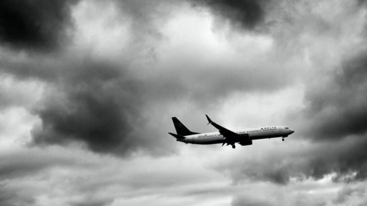 Delta airliner in dark skies
