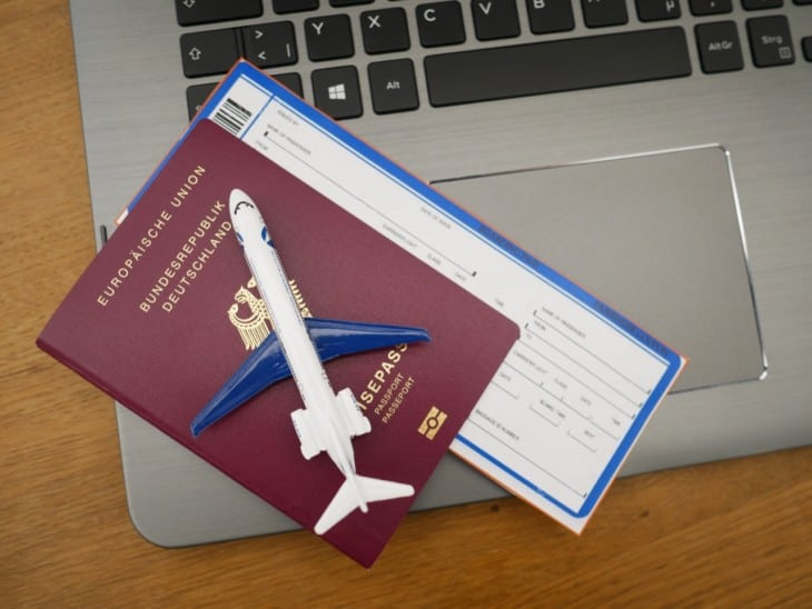 Passport ticket laptop airplane 1