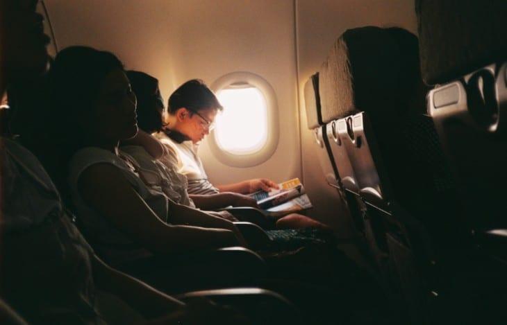 Row of passengers next to open window