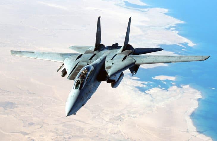 A US Navy F 14 Tomcat aircraft flies a combat mission.