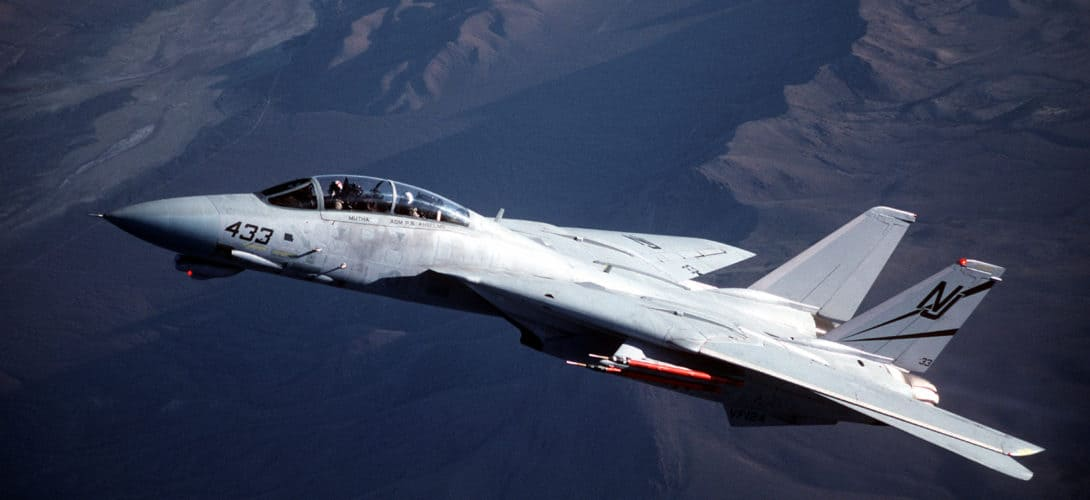 An air to air left side view of a Fighter Squadron 124 VF 124 F 14D Tomcat .