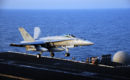 FA 18C Hornet lands on the flight deck of the aircraft carrier USS George H.W. Bush