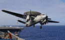 An E 2C Hawkeye assigned to the VAW 115 Liberty Bells is taking off from USS Kitty Hawk