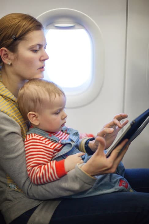 Mother and baby son on board of airplane