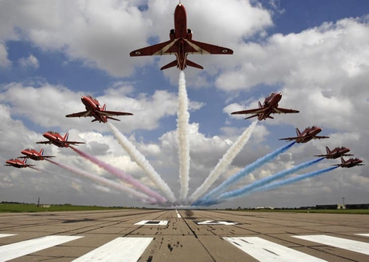 The Red Arrows performing a low level flypast over 04 threshold at RAF Scampton