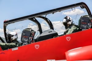 one of the Red Arrows pilots and an Engineer passenger preparing for take off.