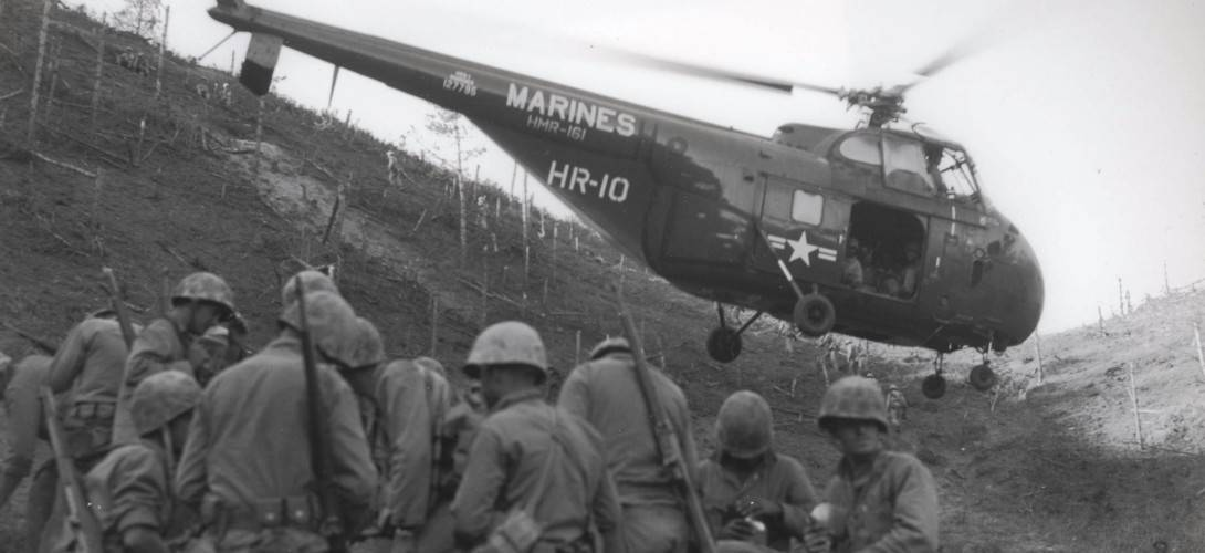 GRS 1 Sikorsky transport helicopter lifts away with a load of casualties after disembarking the Marines in foreground