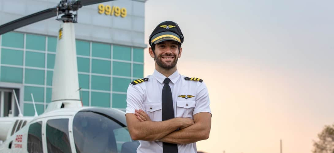 Helicopter pilot in front of helicopter