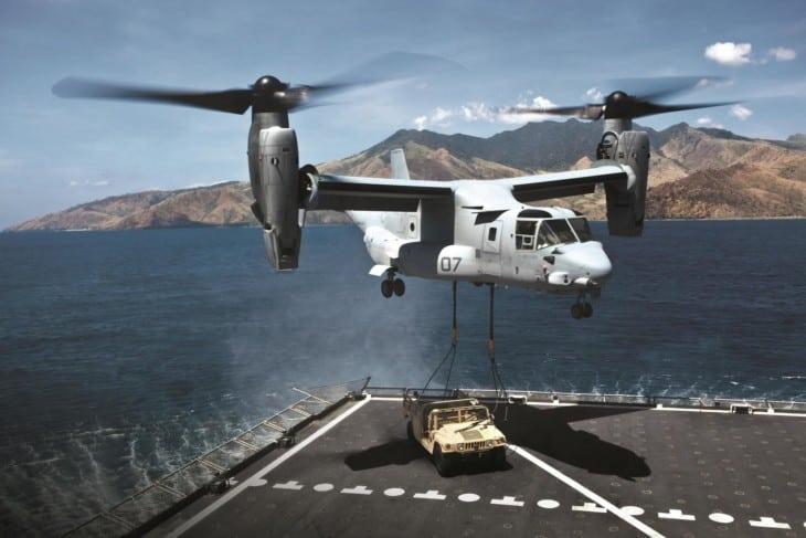 Bell Boeing V 22 Osprey airlifting Hummer