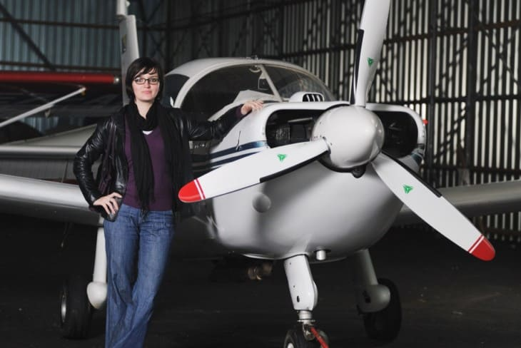 young woman with private airplane