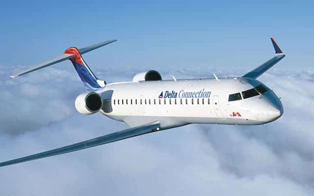 Bombardier CRJ 700 in the clouds
