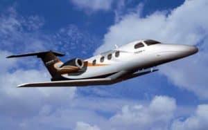 Embraer Phenom 100 blue skies